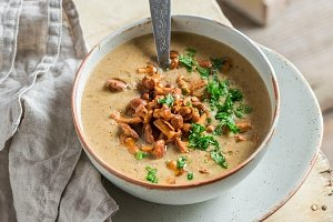 Homemade mushrooms soup with chanterelles and fresh parsley